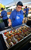 (Bob Raines--Digital First Media)   <br /> Joanne Wiszneski turns kabobs on a grill at the Fourth Annual International Food Fest at St. Philip's Orthodox Church Sept. 16, 2016.
