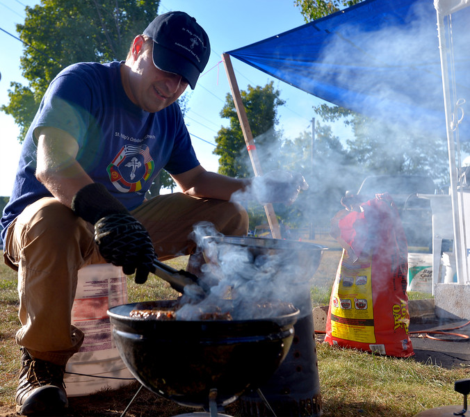 (Bob Raines--Digital First Media)   <br /> Cadalin Timjale grill mici, Rumanian sausage, for the Fourth Annual International Food Fest at St. Philip's Orthodox Church Sept. 16, 2016.