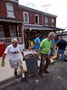 Bob Raines--Digital First Media <br /> Volunteers haul construction waste from a Habitat for Humanity property on Basin St., Norristown, during the Rock the Block community improvement event Sept. 17, 2016.