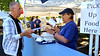 (Bob Raines--Digital First Media)   <br /> Terry Farley collects his dinner order from Mary Ann Reigle at the Fourth Annual International Food Fest at St. Philip's Orthodox Church Sept. 16, 2016.
