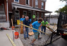 Bob Raines--Digital First Media <br /> Volunteers make a temporary plywood and lumber walkway to bridge area where they dug out a concrete slab in front of a Habitat for Humanity property on Basin St., Norristown, during the Rock the Block community improvement event Sept. 17, 2016.