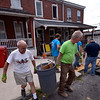(Bob Raines--Digital First Media)    <br /> Volunteers haul construction waste from a Habitat for Humanity property on Basin St., Norristown, during the Rock the Block community improvement event Sept. 17, 2016.