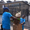 (Bob Raines--Digital First Media)    <br /> Robert McKnight and his son, Isaac, from the First Baptist Church of Norristown, clean up debris in front of Montgomery OIC during the Rock the Block community improvement event Sept. 17, 2016.