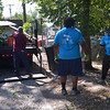 (Bob Raines--Digital First Media)    <br /> Members of Kappa Alpha Psi Community Development Corp., clear away debris from an alley off of Elm St. during the Rock the Block community improvement event Sept. 17, 2016.