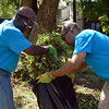 (Bob Raines--Digital First Media)    <br /> LaDon Marsh and Michael Gibson, members of Kappa Alpha Psi Community Development Corp., clear away yard waste around a building on Elm St. during the Rock the Block community improvement event Sept. 17, 2016.