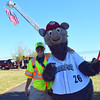 Sellersville fire police Capt. Bill Long stands with Iron Pigs mascot Ferrous at the 2016 SeptemberFest in James Memorial Park in West Rockhill Sunday, Sept. 25.  Debby High — For Digital First Media