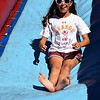 Erin Leight slides down the big slide at the 2016 SeptemberFest in James Memorial Park in West Rockhill Sunday, Sept. 25.  Debby High — For Digital First Media
