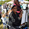 Joe White makes Iesha Archie laugh as he draws a caricature of her son, Nasir, at the 2016 SeptemberFest in James Memorial Park in West Rockhill Sunday, Sept. 25.  Debby High — For Digital First Media