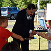 Magician Stuart Rudnick keeps the crowd entertained at the 2016 SeptemberFest in James Memorial Park in West Rockhill Sunday, Sept. 25.  Debby High — For Digital First Media