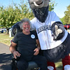 Marty Simon poses with Iron Pigs mascot Ferrous at the 2016 SeptemberFest in James Memorial Park in West Rockhill Sunday, Sept. 25.  Debby High — For Digital First Media