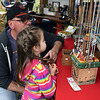 Rick Gebelein and his granddaughter, Leanora, look at jewelry at the Souderton Art Jam Saturday, Sept. 24..  Debby High — For Digital First Media