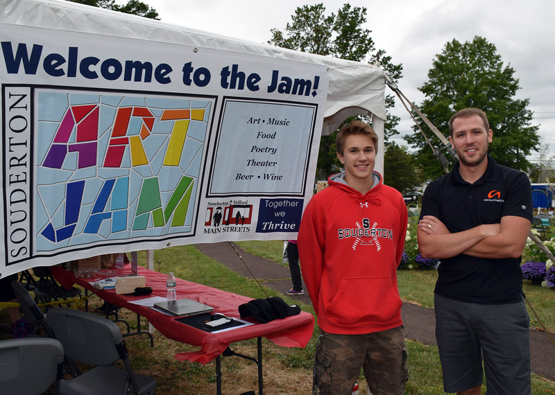Tommy Wassel assisted Andrew Baker, vice president of Abstract Media, at the Souderton Art Jam.  Debby High — For Digital First Media