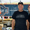 Jesse's Barbecue and Local Market partner Tom Rosenberger, pictured here with Emma Ford, serves up food at the Souderton Art Jam.  Debby High — For Digital First Media