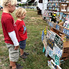 Lucas and Matthew Antonioli look at the license plate art on display at the Souderton Art Jam Saturday, Sept. 24.  Debby High — For Digital First Media