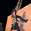 Perkasie firefighter Tim Yannaccone stages a rescue of his dad, fellow firefighter John, from a roof during the Perkasie Fire Company's open house Thursday, Oct. 13.  Debby High — For Digital First Media