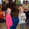 Riley and Reese Hopkins, of Sellersville, meet Smokey the Bear during the Perkasie Fire Company's open house Thursday, Oct. 13.  Debby High — For Digital First Media