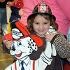 Madison Rex, 4, of Sellersville, smiles for a photo during the Perkasie Fire Company's open house Thursday, Oct. 13.  Debby High — For Digital First Media