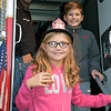Ava Maciocha, of Perkasie, finishes touring a firetruck with her brother during the Perkasie Fire Company's open house Thursday, Oct. 13.  Debby High — For Digital First Media