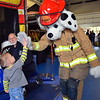 Sparkey offers a high-five during the Sellersville Fire Department's annual open house event Saturday, Oct. 22. Debby High — For Digital First Media