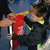 Children receive backpacks with fire safety info at the Sellersville Fire Department's annual open house event Saturday, Oct. 22.  Debby High — For Digital First Media