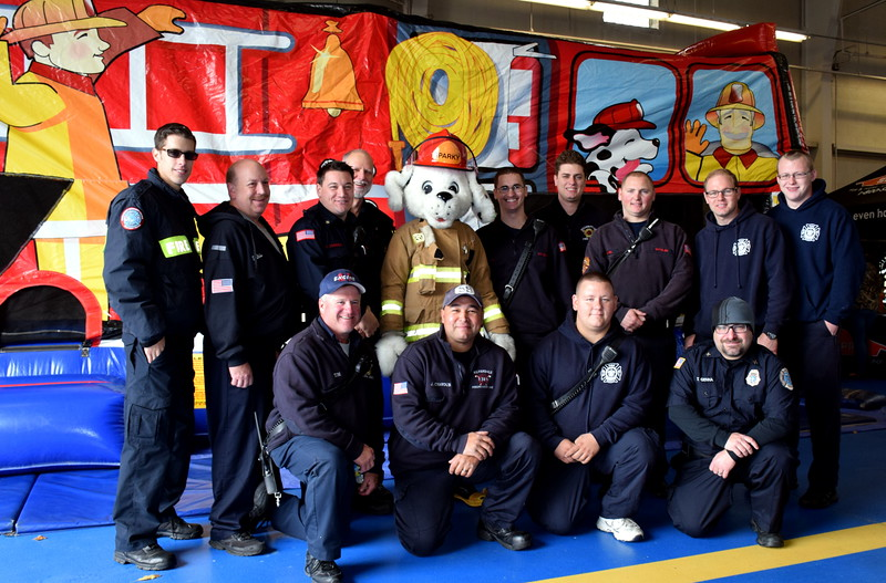 Some of Sellerville Volunteer Fire Department Fire Fighters took a break for a group picture at their annual open house last Saturday. photo by Debby High/Digital First Media  Debby High — For Digital First Media
