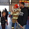 Bianca Benner and her dad, Max Wood, attend the Sellersville Fire Department's annual open house event Saturday, Oct. 22.  Debby High — For Digital First Media