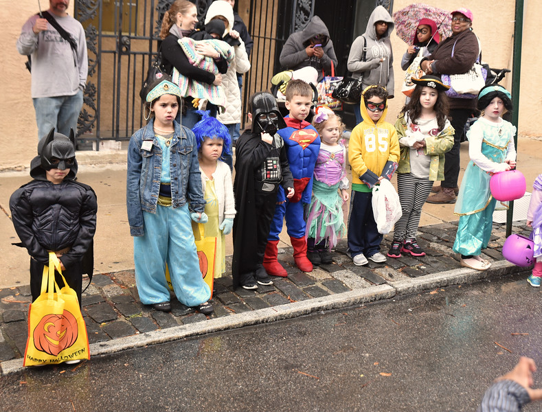 A group of youngsters assemble for a costume judging contest along Cotton Street.  Rick Cawley — For Digital First Media