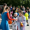 Angela Lang, head librarian at the East Cheltenham Library, hands out treats to participants in the East Cheltenham Halloween Parade Oct. 29.  Rachel Wisniewski — For Digital First Media