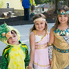 Siblings Fernando Jr., 4, Nialah, 5, and Niya, 7, strike a pose in their dinosaur, goddess and Cleopatra costumes.  Rachel Wisniewski — For Digital First Media