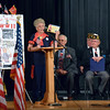 Mae Krier addresses the audience at the annual Veterans Day program at Strayer Middle School Friday, Nov. 11.  Debby High — For Digital First Media