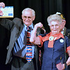 Paul Clymer introduces Mae Krier at the annual Veterans Day program at Strayer Middle School Friday, Nov. 11.  Debby High — For Digital First Media