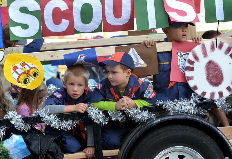 Cubs look out from the Scouts in Toyland float at the passing scene in the Lansdale Mardi Gras Parade Nov. 19, 2016.   |   Bob Raines--Digital first Media