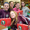 Faith Christian Academy students take part in packing boxes for Operation Christmas Child at Faith at Sellersville's packing party.  Debby High — For Digital First Media