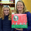 Sixth-grader Destiney Drum and Liz Thompson, relay center coordinator of Operation Christmas Child, are pictured at Faith at Sellersville's packing party for Operation Christmas Child.  Debby High — For Digital First Media