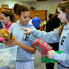 Volunteers pack boxes for Operation Christmas Child at Faith at Sellersville's packing party.  Debby High — For Digital First Media