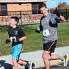 Tim Belotserkorsky is joined by his dad, Vitaly, who placed second overall, to finish Willow Dale Elementary School's Puma 5K Nov. 12.  Debby High — For Digital First Media