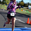 Willow Dale Elementary physical education teacher Tracy Jenkin crosses the finish line of Willow Dale Elementary School's Puma 5K Nov. 12.  Debby High — For Digital First Media