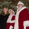 Board of supervisors Vice Chairwoman Kathleen Hunsicker stands  with Santa Claus and Mrs. Claus during the Lower Gwynedd tree lighting service at Veterans Park Nov. 26.  Jeff Davis - For Digital First Media