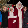 Kathleen Rodgers, left, Kathleen Hunsicker, Mrs. Claus, Santa and Denise Marbach take a photo at the Lower Gwynedd tree lighting ceremony. Jeff Davis - For Digital First Media