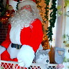 Santa and his canine friend welcome visitors to Pearl S. Buck International's 38th annual Festival of Trees.  Debby High — For Digital First Media