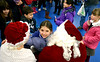 Abby McMullen gives Santa and Mrs. Claus a big hug after making her Christmas requests Dec. 6, 2016.   |   Bob Raines--Digital First Media