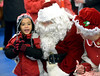 Five-year-old Jazius Alicea runs down the list of things he would like for Christmas when he meets Santa and Mrs. Claus at the Sellersville Firehouse during Winterfest Dec. 6, 2016.   |   Bob Raines--Digital First Media