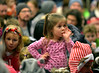 A little girl finds a tasty thumb goes well with stories read by Santa and Mrs. Claus in the Ambler Borough Hall auditorium Dec. 8, 2016.   |   Bob Raines--Digital First Media