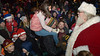 Santa stops to talk to a girl sitting on her father's shoulders as he makes his way down the ramp and into the throng at the Ambler SEPTA station.   |   Bob Raines--Digital First Media