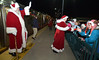 Santa and Mrs. Claus are greeted by happy children as the step off a northbound SEPTA train in Ambler Dec. 8, 2016   |   Bob Raines--Digital First Media