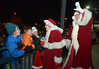 Santa waves to the crowd as Mrs. Claus talks to children hanging on the railing at the Ambler SEPTA station Dec. 8, 2016.   |   Bob Raines--Digital First Media