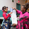 Favor Oluwole opens up her gift from Santa Claus: a train set. Favor's mother, who is helping her to open the present, remarked that Favor had just been saying that she wanted a train set for Christmas.  Rachel Wisniewski — For Digital First Media