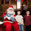 Brothers Michael Ferrari, 18 months, left, Aiden Staller, 7, center, and Devon Staller, 5, pose for a photograph with Santa Clause at the Willow Grove VFW Post 3612 Children's Christmas Party.  Rachel Wisniewski — For Digital First Media