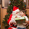 Aiden Staller, 7, is overjoyed to meet Santa Claus.  Rachel Wisniewski — For Digital First Media