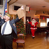 Commander Ed Heary throws his hands in the air with excitement as Santa Claus enters the Willow Grove VFW Post 3612 building.  Rachel Wisniewski — For Digital First Media
